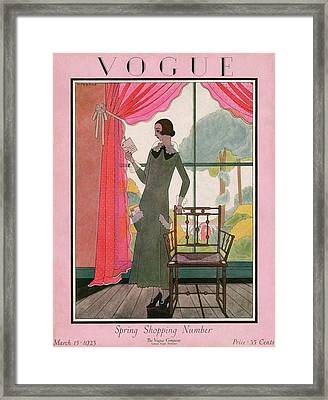 A Vogue Cover Of A Woman Reading A Letter Framed Print by Harriet Meserole