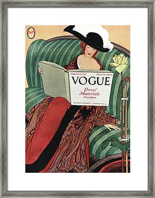 A Vogue Cover Of A Woman Reading A Vogue Book Framed Print by George Wolfe Plank