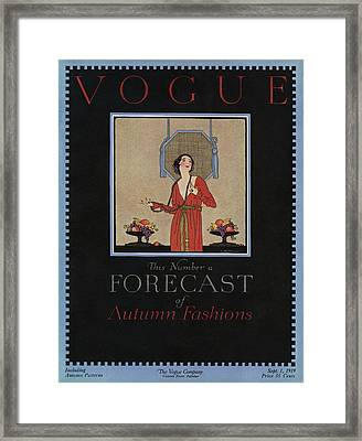 A Vogue Cover Of A Woman Wearing A Red Dress Framed Print by Dorothy Holman
