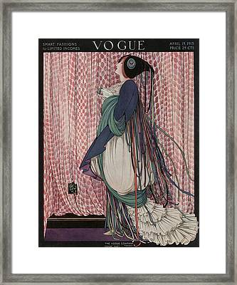 A Vogue Cover Of A Woman Wearing A Ribboned Dress Framed Print by George Wolfe Plank