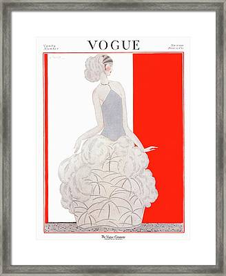 A Vogue Cover Of A Woman Wearing An Evening Gown Framed Print by Georges Lepape
