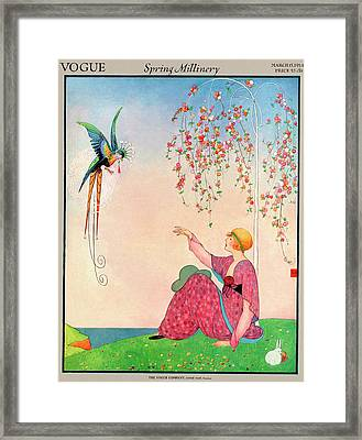A Vogue Cover Of A Woman With A Bird Framed Print by George Wolfe Plank