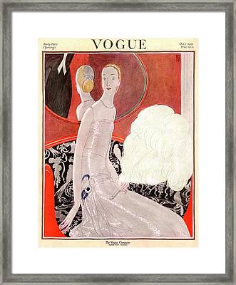 A Vogue Cover Of A Woman With A Fan Framed Print
