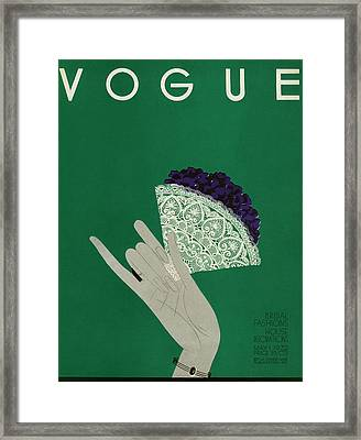 A Vogue Cover Of A Woman's Hand Holding Flowers Framed Print by Eduardo Garcia Benito