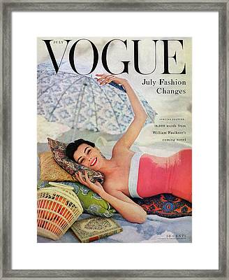 A Vogue Cover Of Anne Gunning Under An Umbrella Framed Print by Karen Radkai