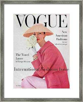 A Vogue Cover Of Evelyn Tripp Wearing Pink Framed Print by Karen Radkai