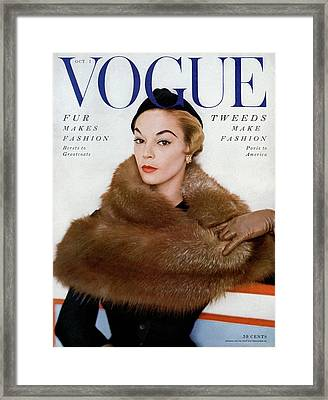 A Vogue Cover Of Jean Patchett Wearing A Fur Wrap Framed Print by Horst P. Horst