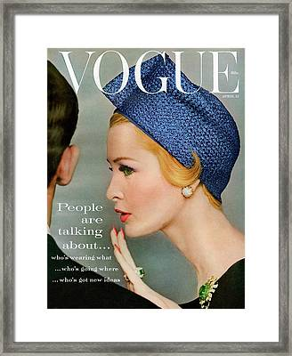 A Vogue Cover Of Sarah Thom Wearing A Blue Hat Framed Print by Richard Rutledge