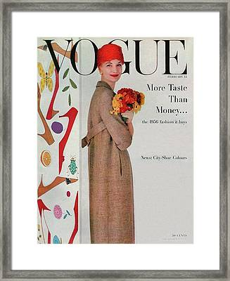 A Vogue Cover Of Sunny Harnett With Flowers Framed Print by Karen Radkai