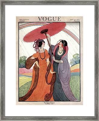 A Vogue Cover Of Women Under An Umbrella Framed Print