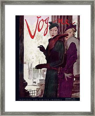 A Vogue Cover Of Women Wearing Coats Framed Print by Pierre Mourgue