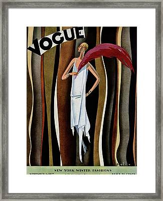 A Vogue Magazine Cover Of A Woman Framed Print by William Bolin