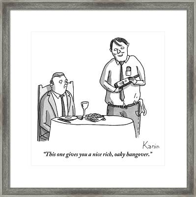 A Waiter Describes The Bottle Of Wine He Holds Framed Print