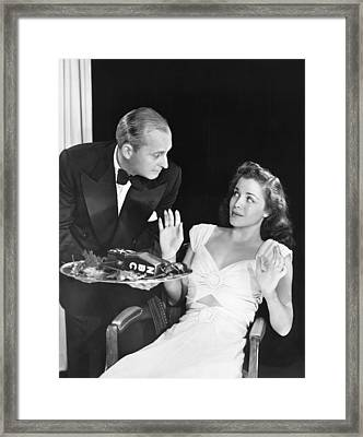 A Waiter Offers A Microphone Framed Print by Underwood Archives