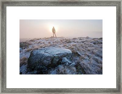 A Walker On The Summit Of Caudale Moor Framed Print