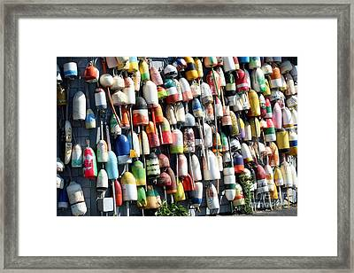 A Wall Of Bouys Framed Print by Rosemary Aubut