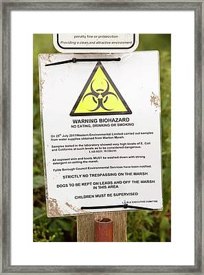 A Warning About E. Coli Contamination Framed Print by Ashley Cooper