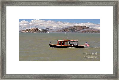 A Water Taxi Cruises Past Alcatraz Framed Print by Jim Fitzpatrick