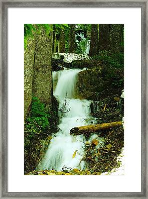A Waterfall In Spring Thaw Framed Print by Jeff Swan