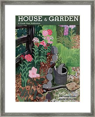 A Watering Can And A Shovel By A Flower Bed Framed Print