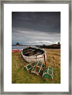 A Weathered Boat And Fishing Equipment Framed Print by John Short