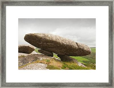 A Weathered Granite Boulder Framed Print