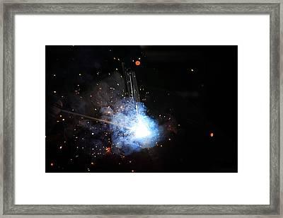 A Welder's Universe Framed Print by Daniel Alcocer