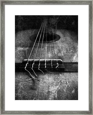 A Well Played Guitar Framed Print