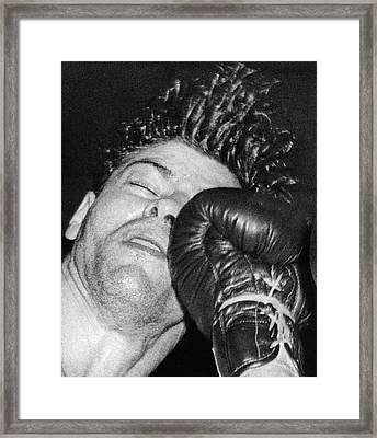 A Welterweight Uppercut Framed Print by Underwood Archives