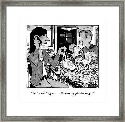 A Wife And Husband Sort Through A Pile Of Plastic Framed Print
