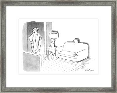 A Wife Stands In The Doorway Of The Living Room Framed Print