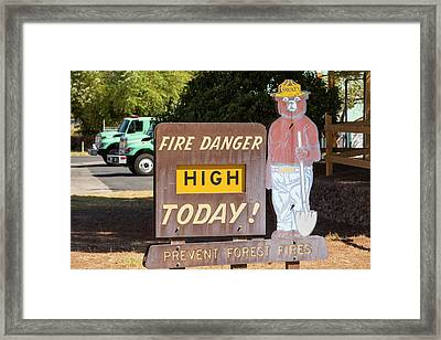 A Wildfire Danger Sign In Springville Framed Print by Ashley Cooper