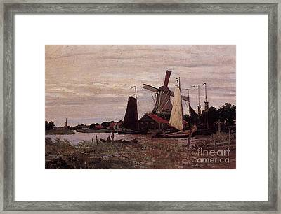 A Windmill At Zaandam Framed Print by Claude Monet
