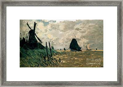 A Windmill Near Zaandam Framed Print by Claude Monet