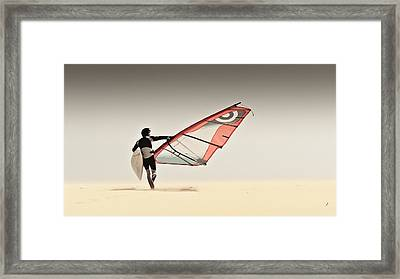 A Windsurfer Runs On The Sand Of Punta Framed Print by Ben Welsh