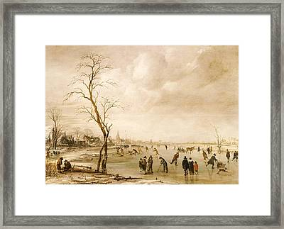 A Winter Landscape With Townsfolk Skating And Playing Kolf On A Frozen River Framed Print by Aert van der Neer