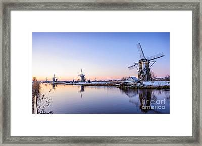 A Cold Winter Morning With Some Windmills In The Netherlands Framed Print