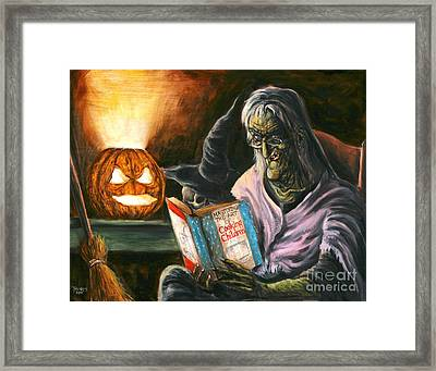 A Witch Reading Framed Print by Mark Tavares