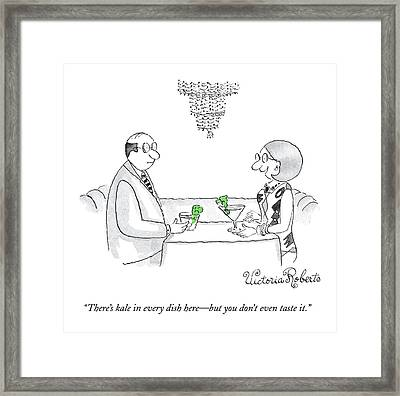 A Woman Addresses A Man Across A Restaurant Table Framed Print