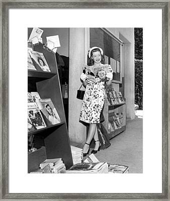 A Woman At A Magazine Stand Framed Print by Underwood Archives
