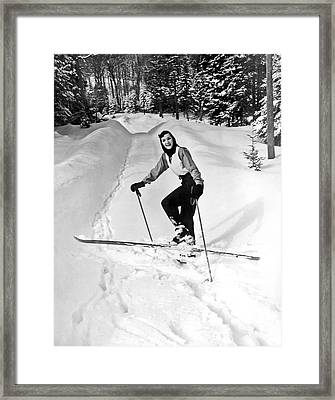 A Woman Cross Country Skiing Framed Print by Underwood Archives