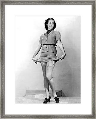 A Woman Displays Her Garters Framed Print by Underwood Archives
