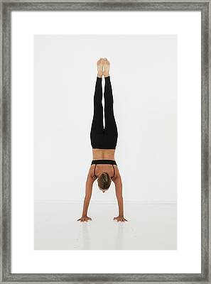 A Woman Doing A Handstand On A White Framed Print