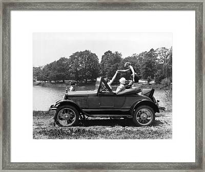 A Woman Exiting A Rumble Seat Framed Print