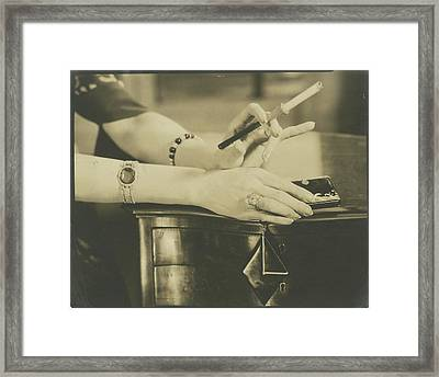 A Woman Holding A Cigarette Holder Framed Print by Edward Steichen