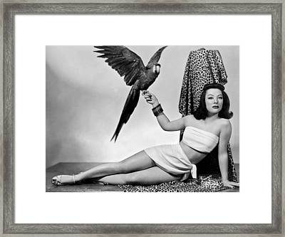 A Woman Holding A Parrot Framed Print by Underwood Archives