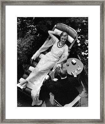 A Woman In A Chiffon Tea Gown In A Chaise Longue Framed Print
