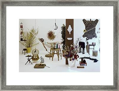 A Woman In A Hammock And Porch Furniture Framed Print by Tom Yee