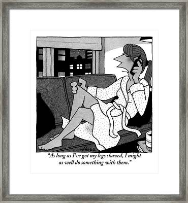 A Woman In A Robe On A Couch Speaking Framed Print