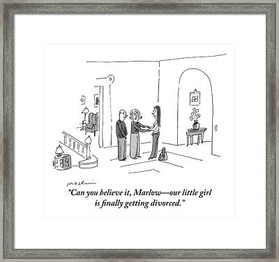 A Woman Is Seen In A Home Holding Hands Framed Print by Michael Maslin